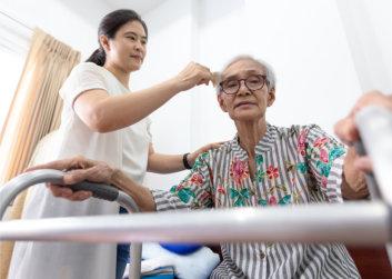 caregiver taking care of senior patient
