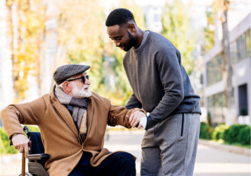 caregiver assisting patient in standing