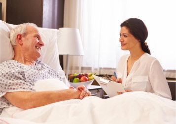 caregiver doing assessment on senior man